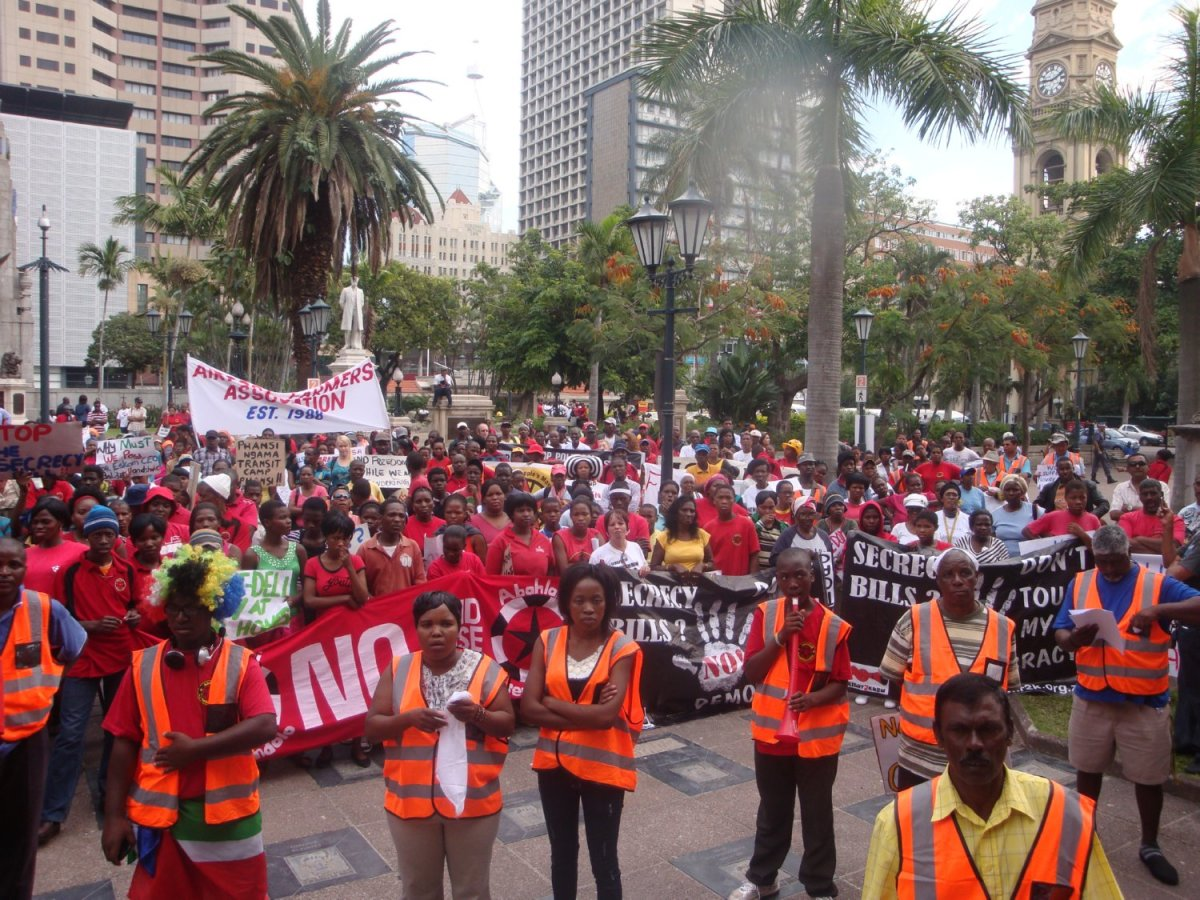 Abahlali baseMjondolo displaying their posters which depict their grievances and demands