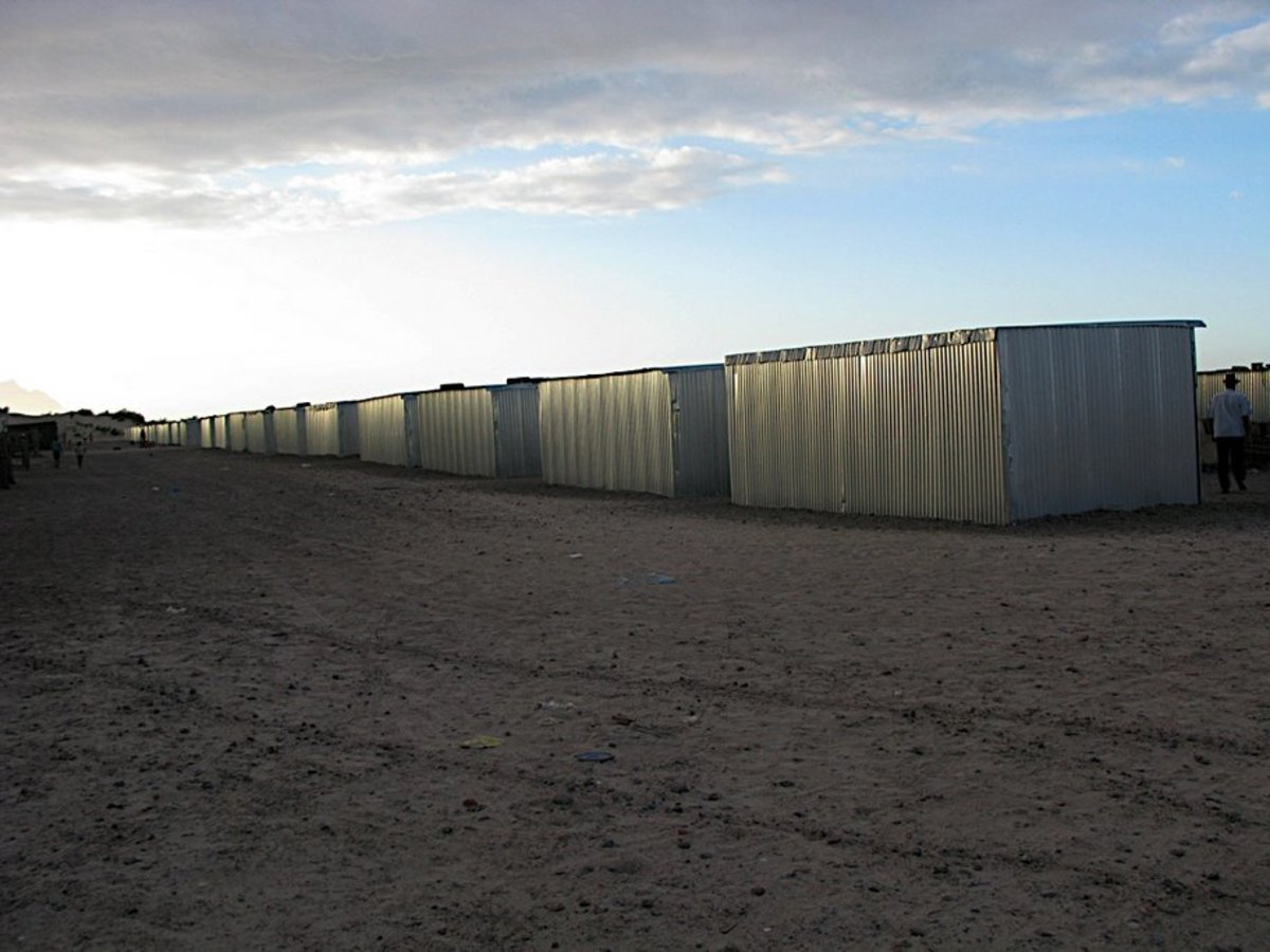 Back section of the tin shacks as they were being lined up