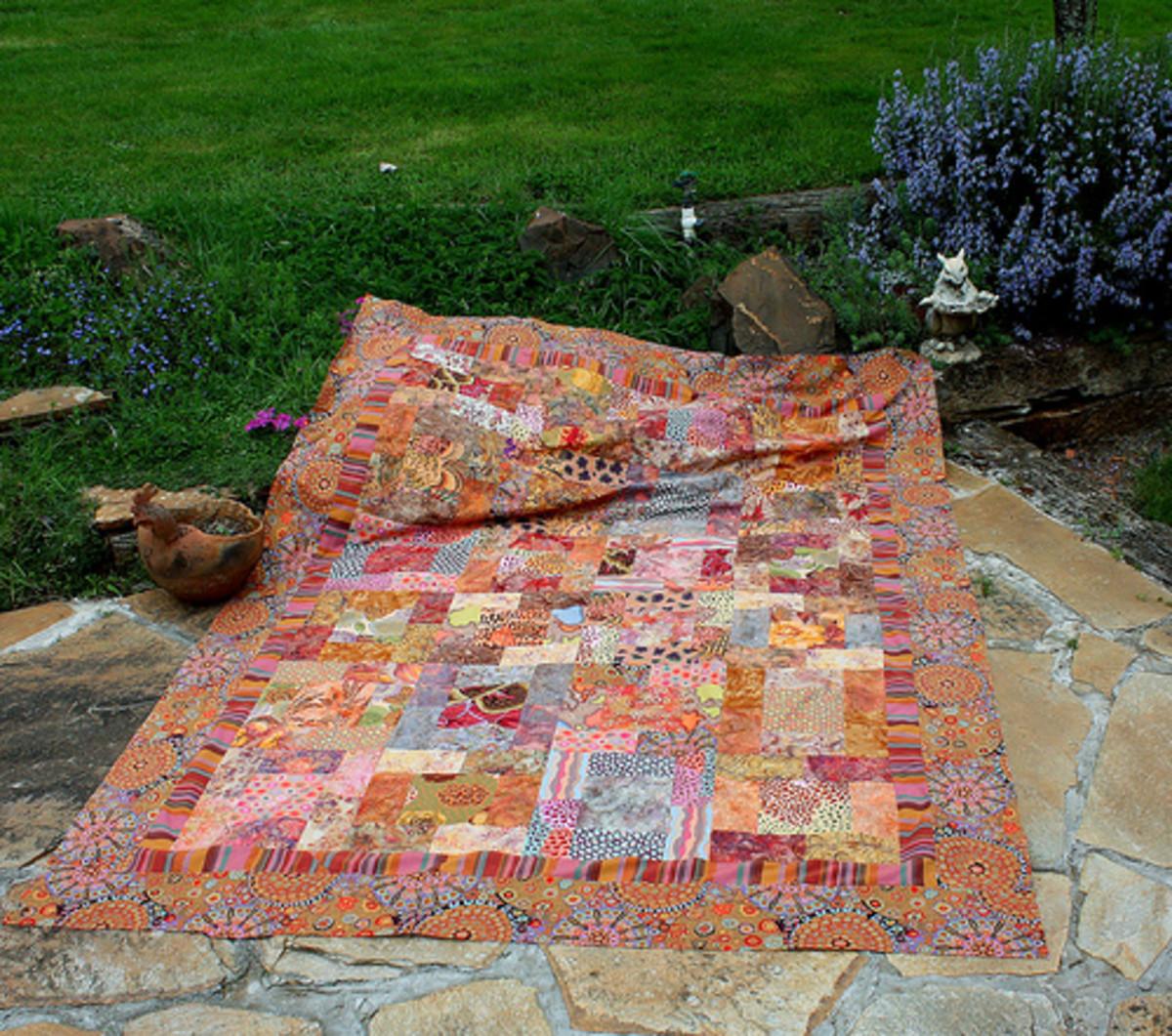 Batik quilt in warm colors