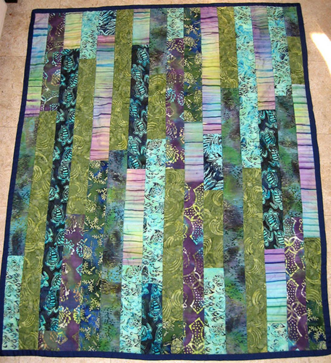 Batik strip quilt in cool colors