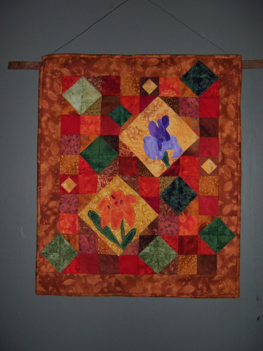 This quilt combines traditional and batik fabrics.