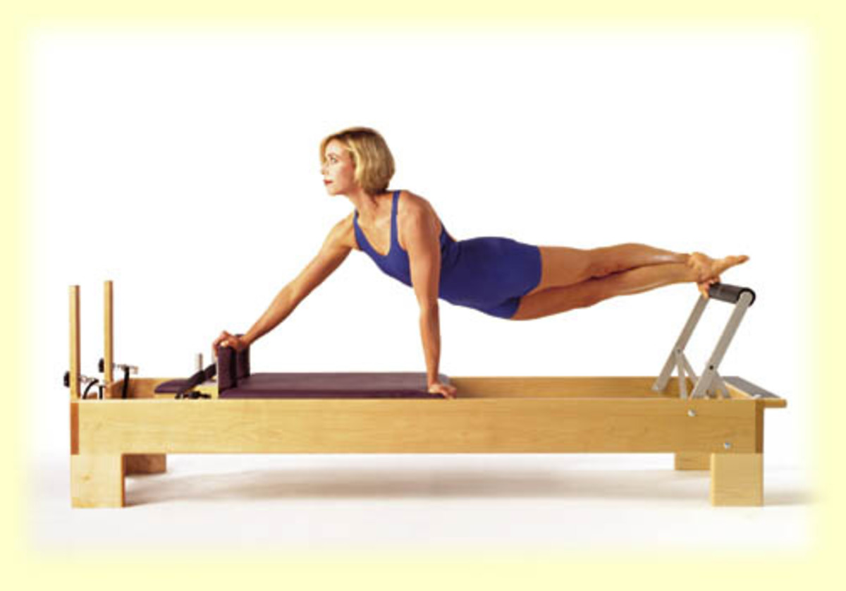 Young woman exercising on the Pilates Reformer
