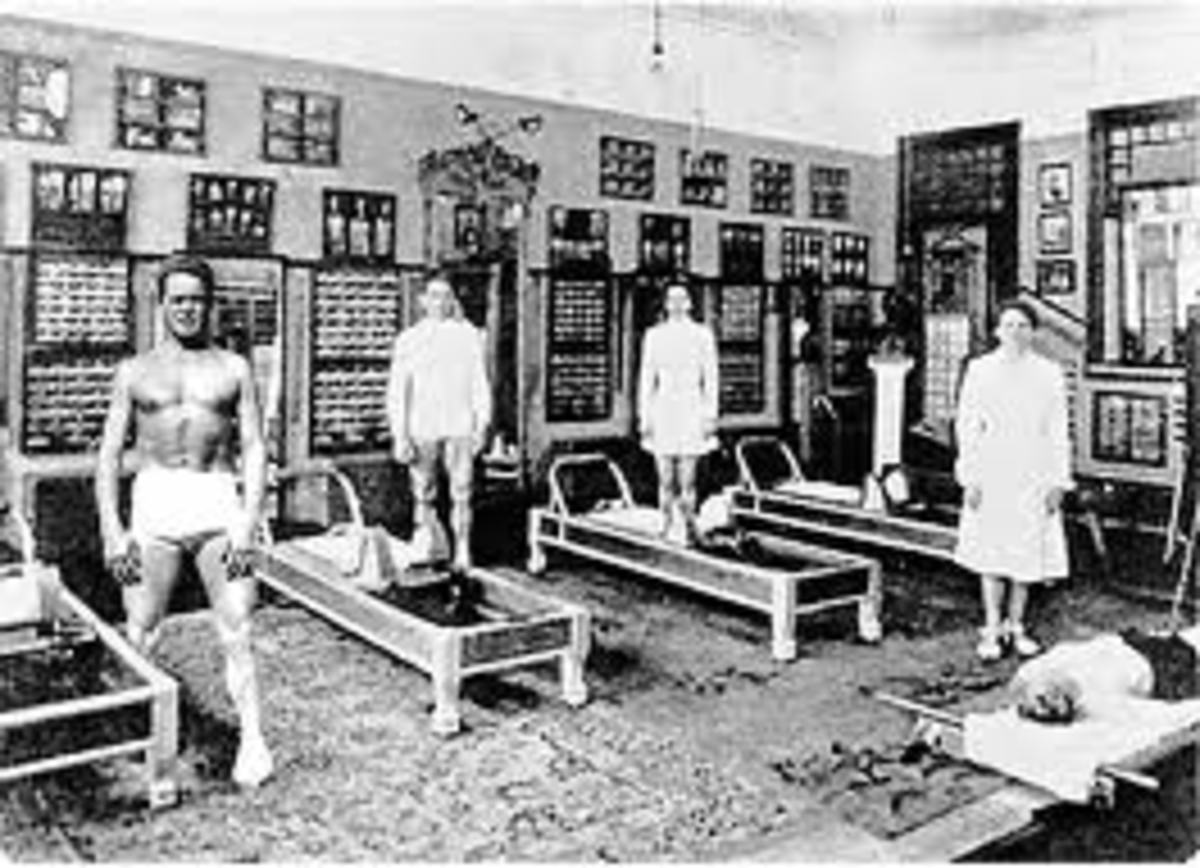 Pilates Studio with Four Men and Four Pilates Reformers in Black and White