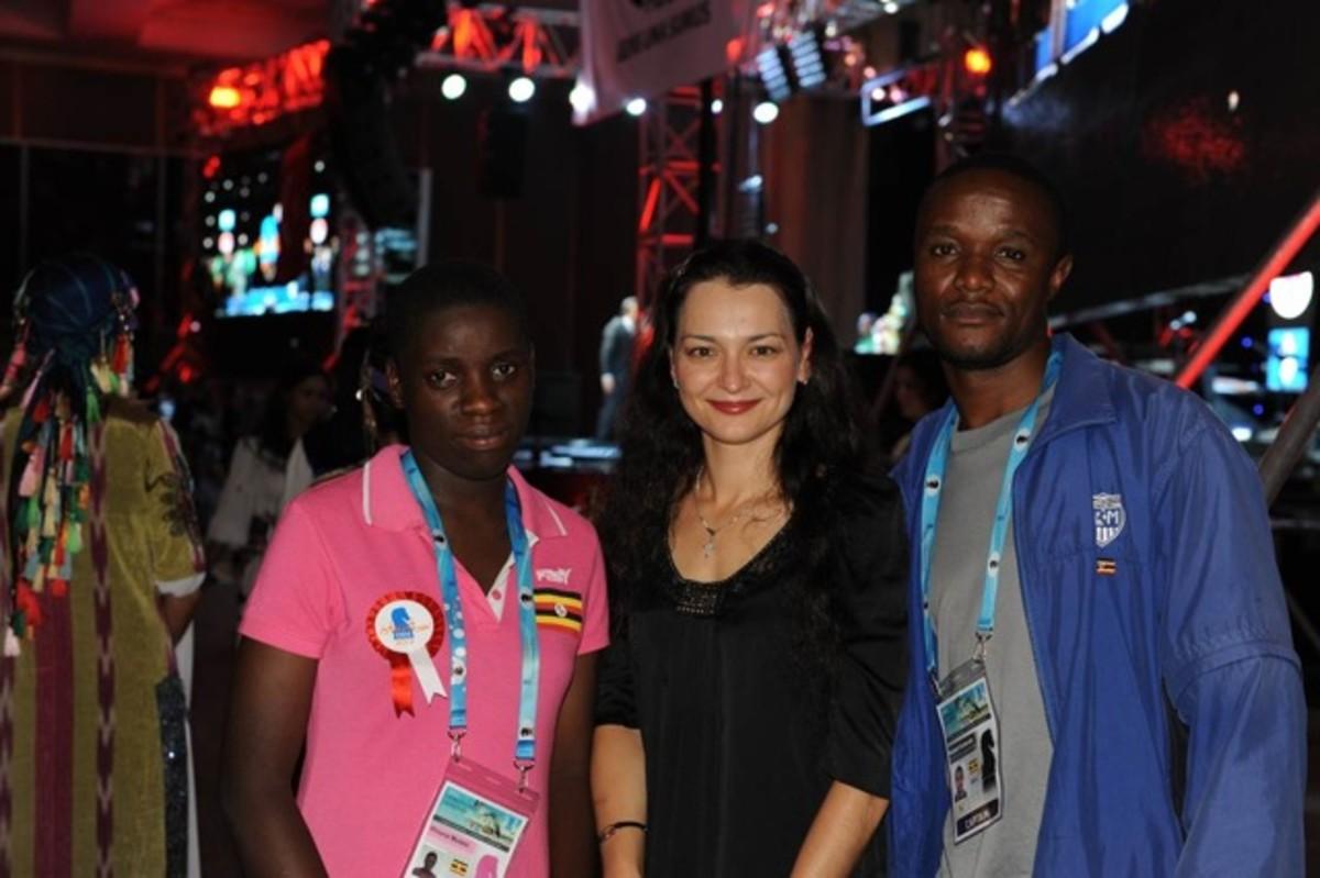 Phiona Mutesi with Grandmaster Alexandra Kosteniuk and coach Robert Katende
