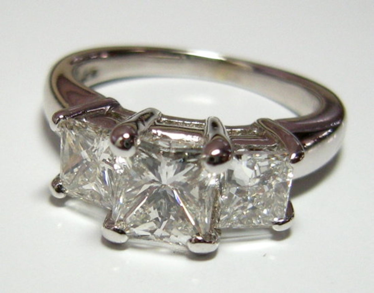 A Princess Cut Three-Stone Ring