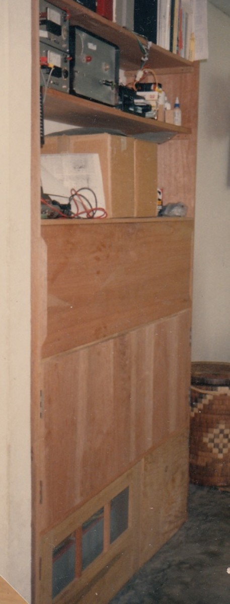 A centrally-located storage cabinet housed batteries below and charge controller above, doubling as linen closet, etc.