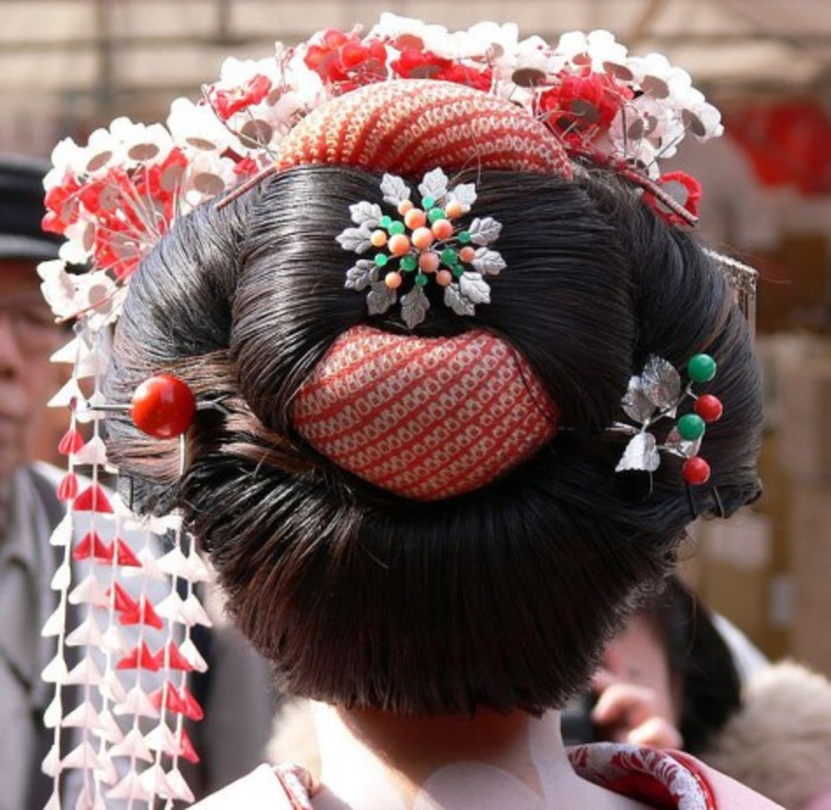 Warenshinobu Style - worn with a kanzasi or hair ornament for a maiko's debut.  (A maiko is an apprentice)