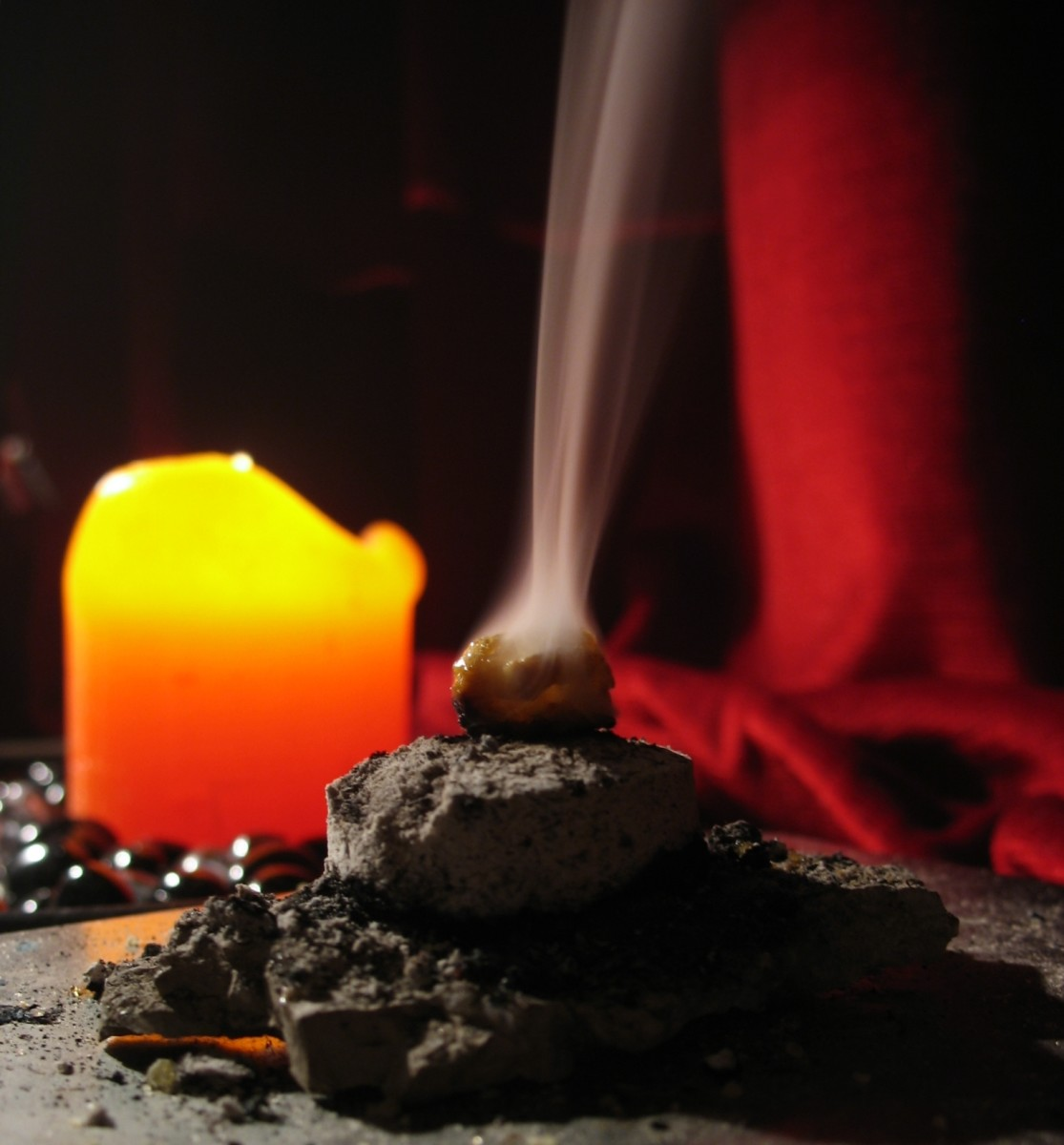 frankincense being burnt on hot coals.