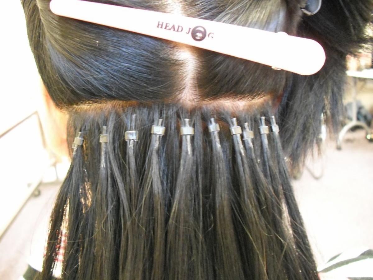 Micro-ring extensions - Notice the individually ringed hair sections and how each micro-loop is installed..