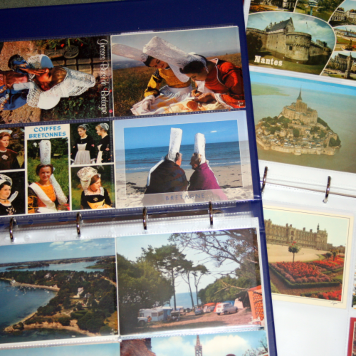 Two albums of postcards from France