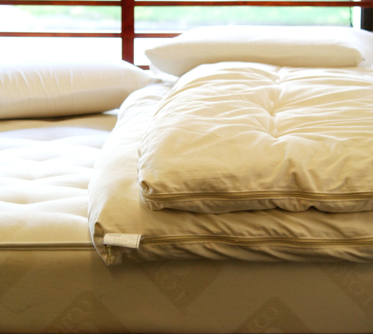 'Plush' Mattress with some comfort layers - add more with a topper.