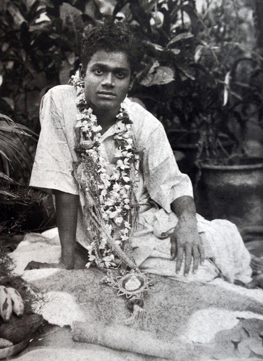"Swami seated on the ""Sai Baba Gundu"" or the Sai Baba rock on which He gave His first ever sermon to humanity -  Manasa Bhajare guru Charanam."