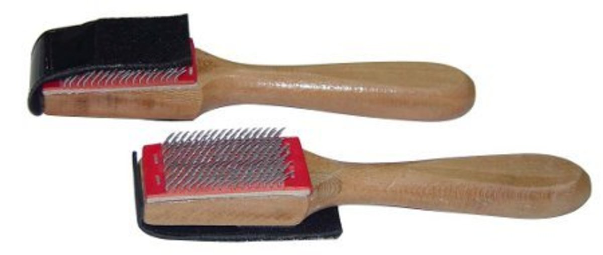 Most shoe brushes come with a leather flap that covers the metal bristles on the brush so they don't damage other items in your bag or hurt your hands when you're handling your brush to put it away