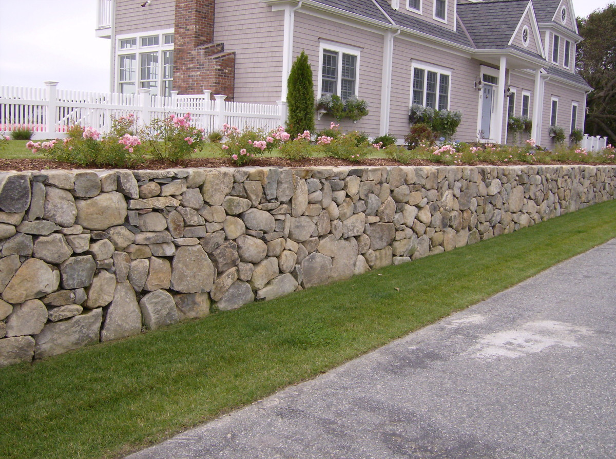Although this picture has been taken from the internet, where I could not find what I wanted. This is how a hybrid rock wall can look like if built properly, and as explained in this text. But in the text it is different shape.
