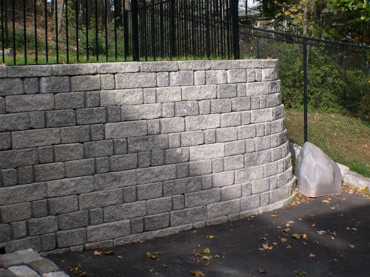 There are many types of retaining walls, this is a masonry stone retaining wall, these types of retaining walls last for a very long time, when they are well build, like the one here, but they cost a lot more than other types of retaining walls.