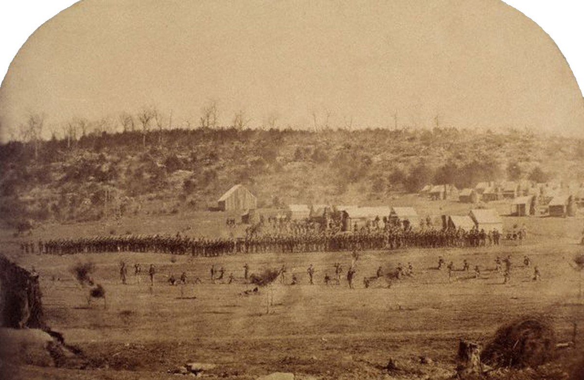 Photo of a Skirmish Drill. The dispersed troops in the foreground are the Skirmishers. The Line of Battle behind them is the remaining eight or so Companies of the  Battalion