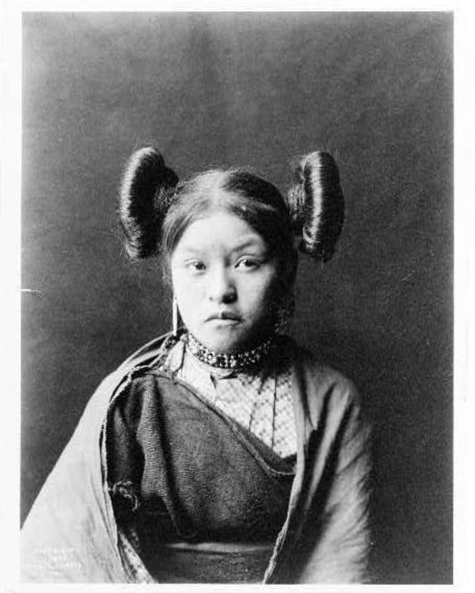 "A young Hopi girl at Walpi circa. 1900 with ""squash blossom"" hairdo indicative of her eligibility for courtship."