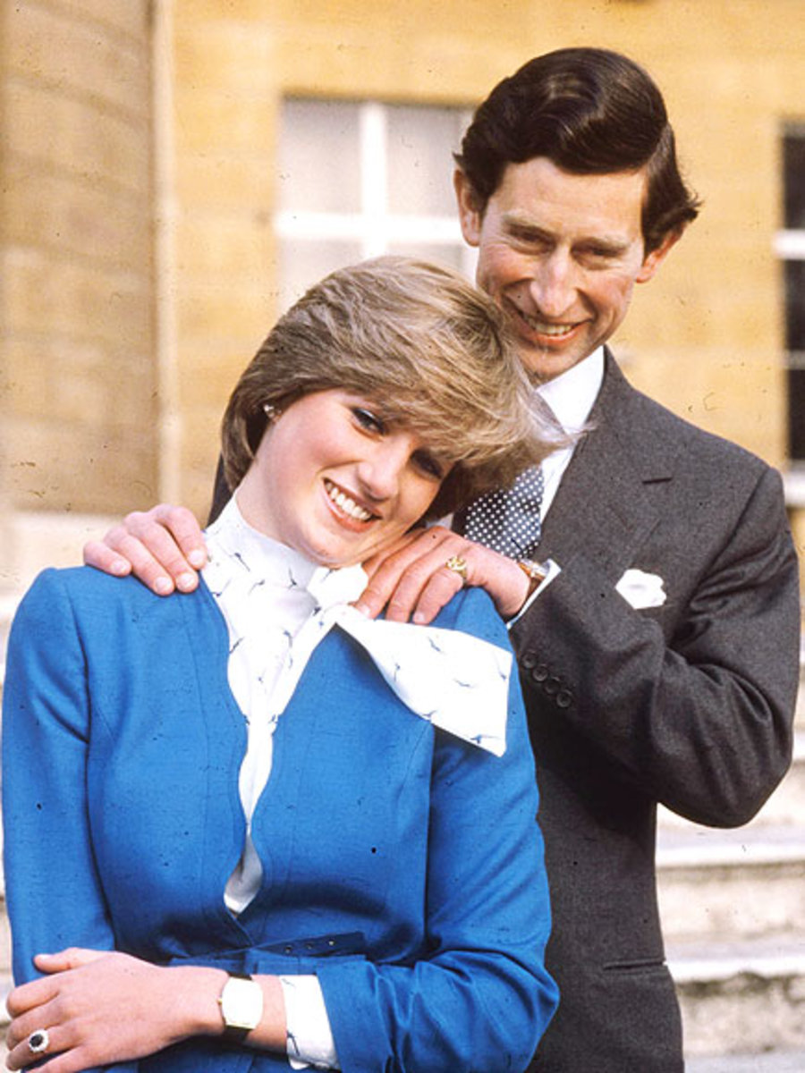 First photograph after engagement announcement, Prince Charles, age 32, with his fiancée, Lady Diana Spencer, 19, outside Buckingham Palace - Feb. 24, 1981