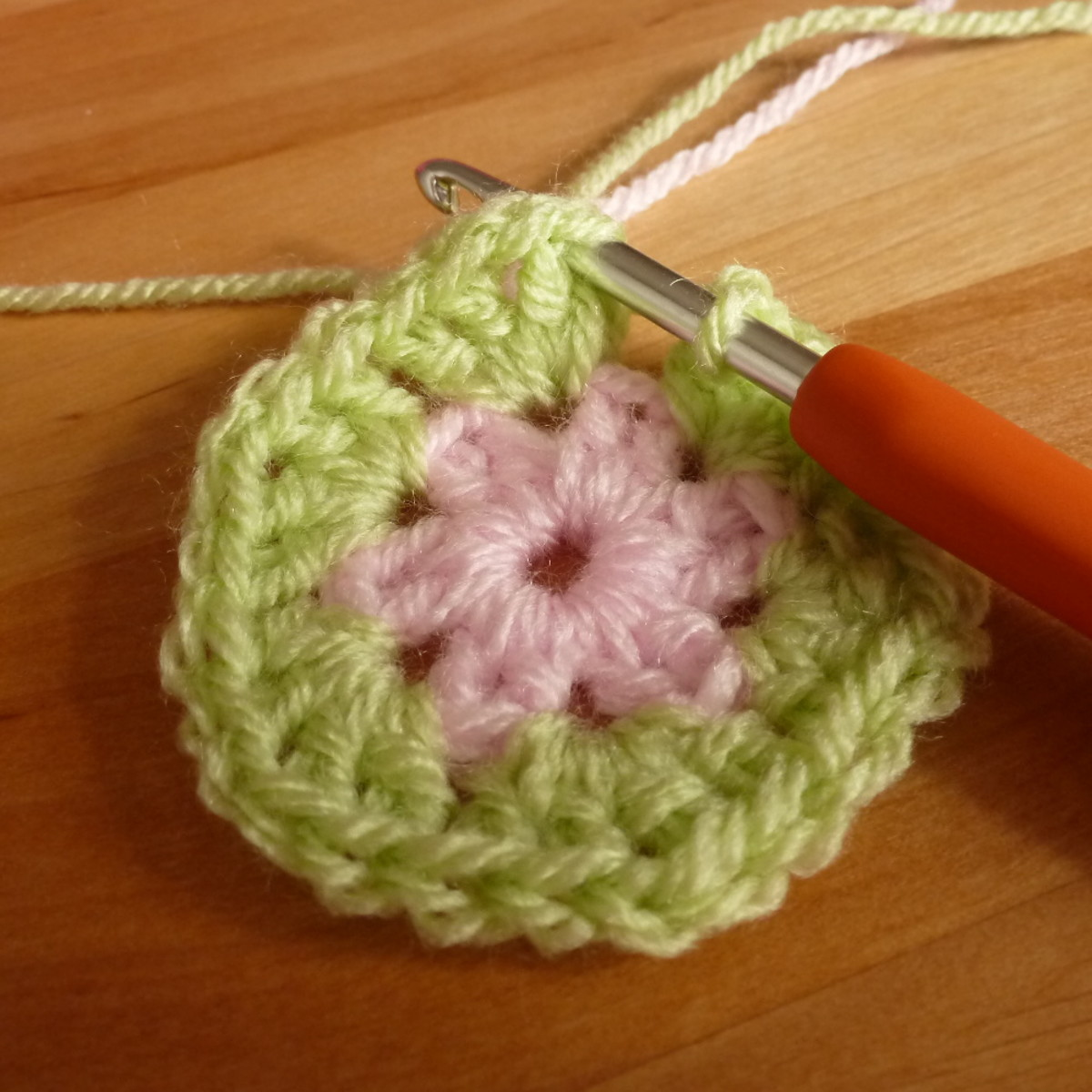 Adding in a second color to the large crochet flower design.