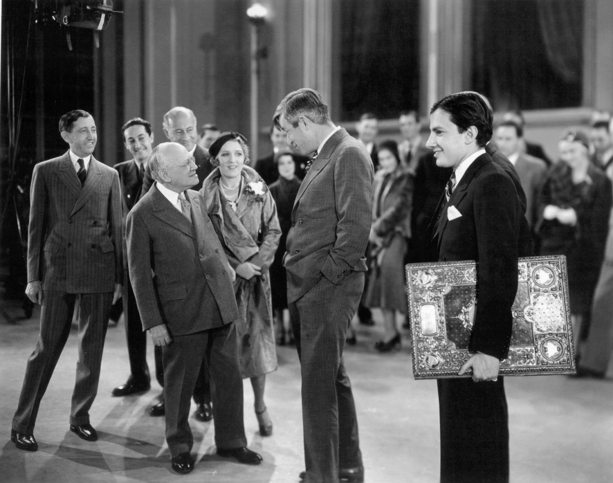 February 6,1931. Photo of a celebration of Carl Laemmle's 25th anniversary in motion pictures. At back, from left-Will H. Hays, Irving Thalberg, Cecil B. DeMille. Front from left-Carl Laemmle, Mary Pickford, Will Rogers and Carl Laemmle, Jr.