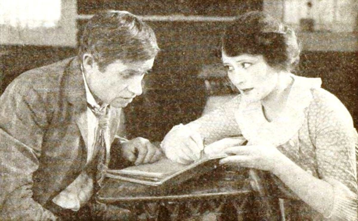 A Still from Boys Will Be Boys (1921) with Will Rogers and Irene Rich, on page 57 of the August 1921 Photoplay.