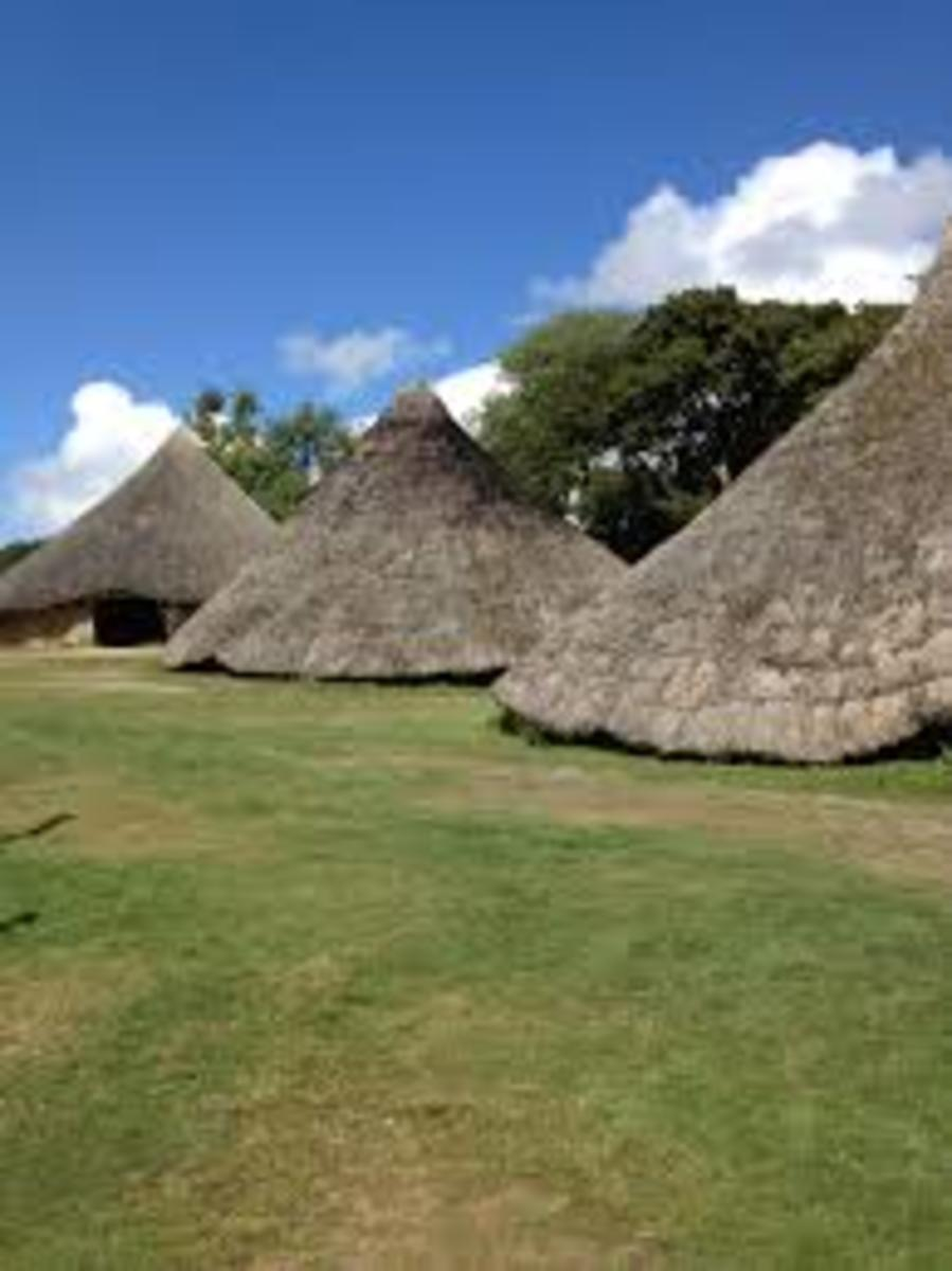 Reconstructed round thatched houses of the Britons (Celts).