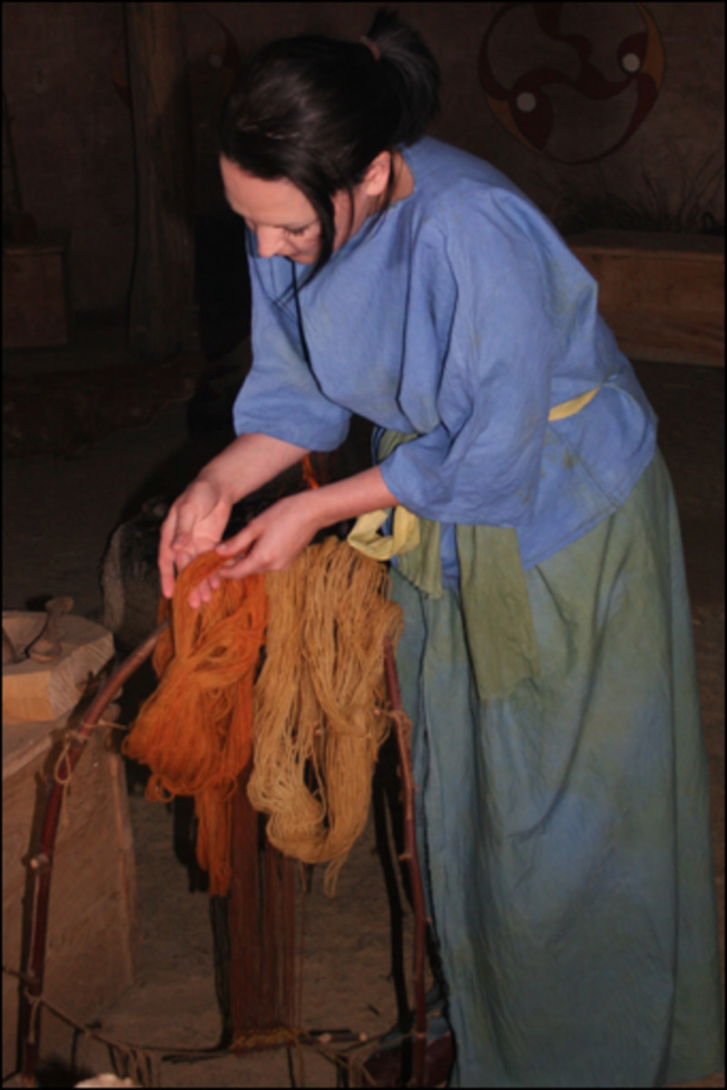 Typical Briton / Celtic woman's clothing.  Dying spinning wool.