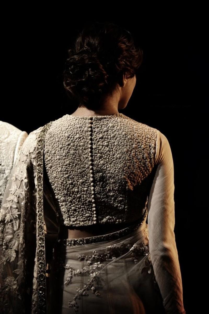 Sabyasachi saree blouse back with potli buttons. Absolutely sensationally elegant Ivory colored Sabyasachi Designer Blouse back