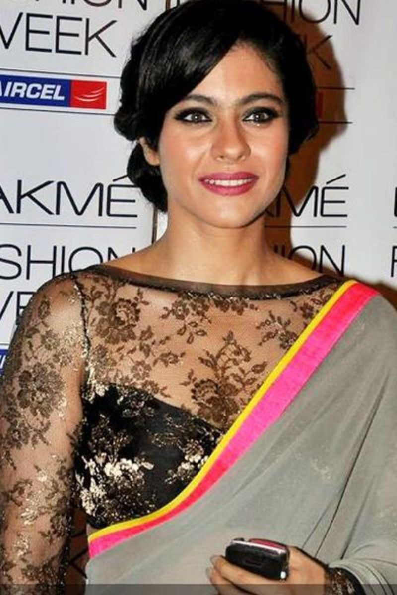 Lace Black Saree Blouse. The blouse isn't bad but worn with this saree it looks gaudy and the lining seems a bit to low for her body type.