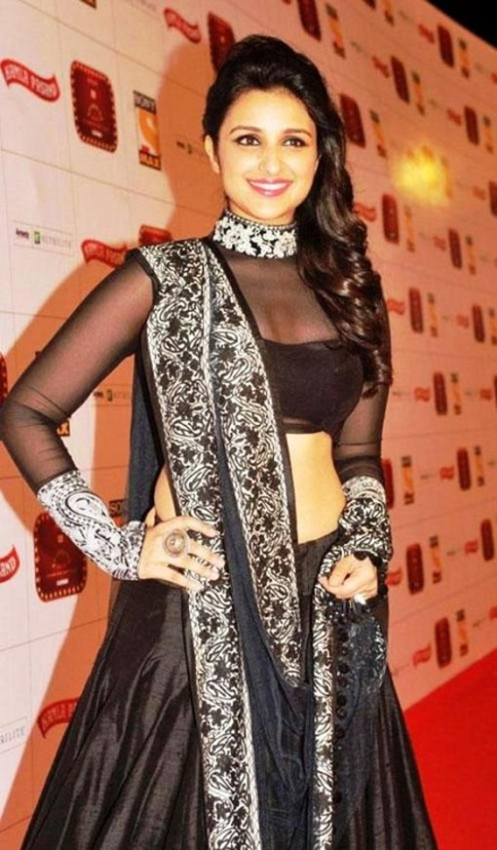 Black high round neck saree blouse with half body lining.