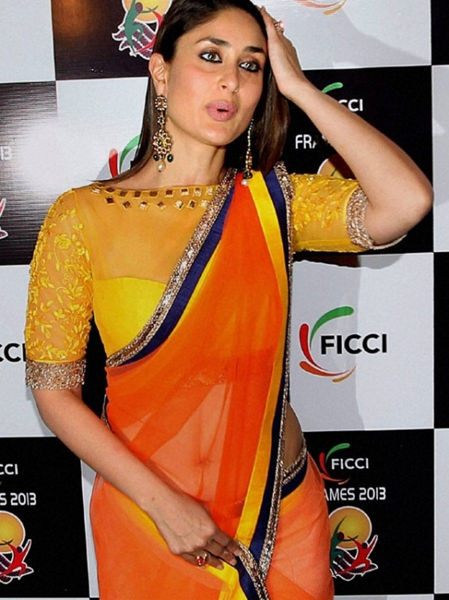 curtained front blouse. Kareena in yellow and orange saree.