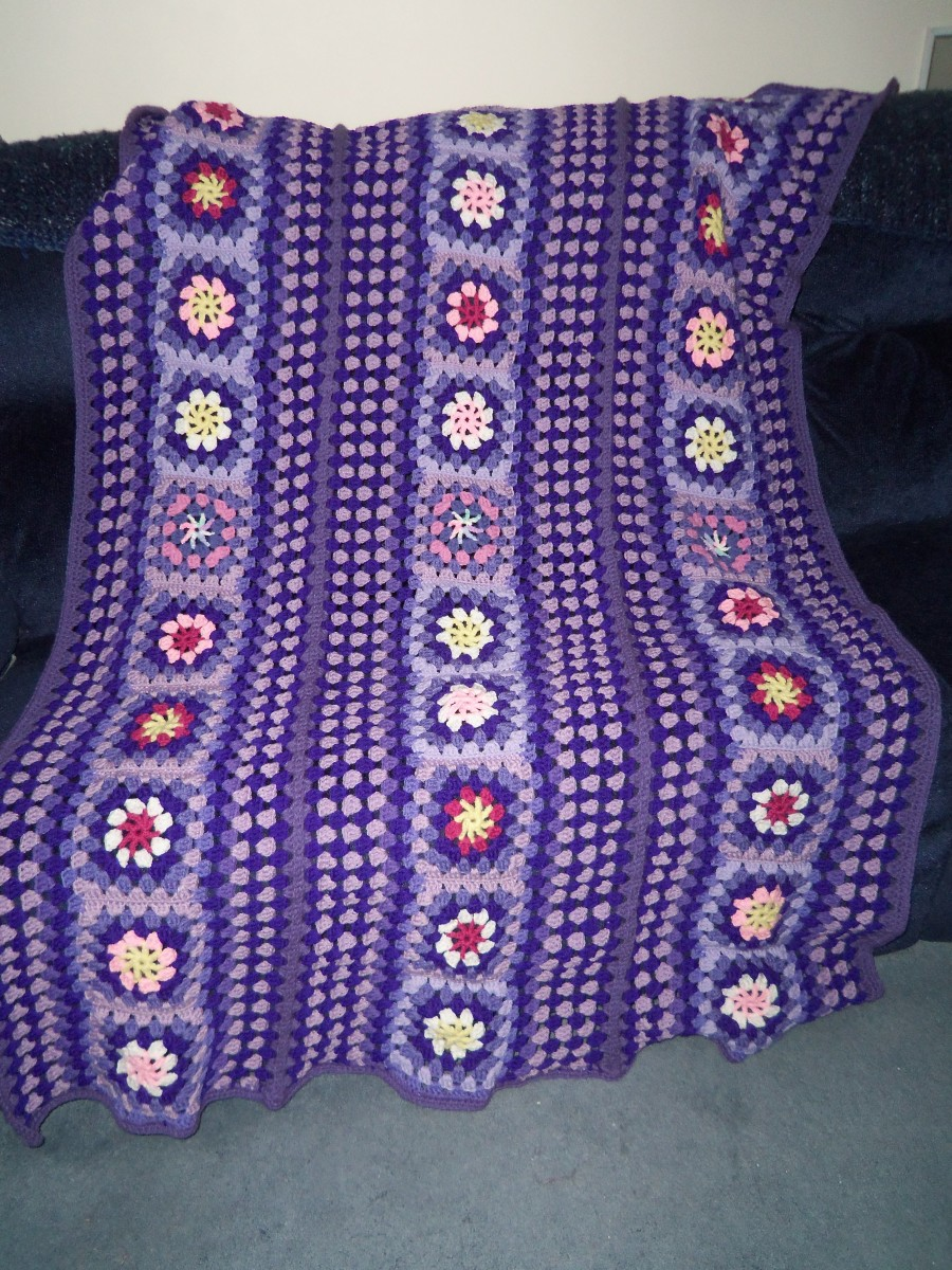 Finished Afghan using all three strips plus my purple yarn from my stash.