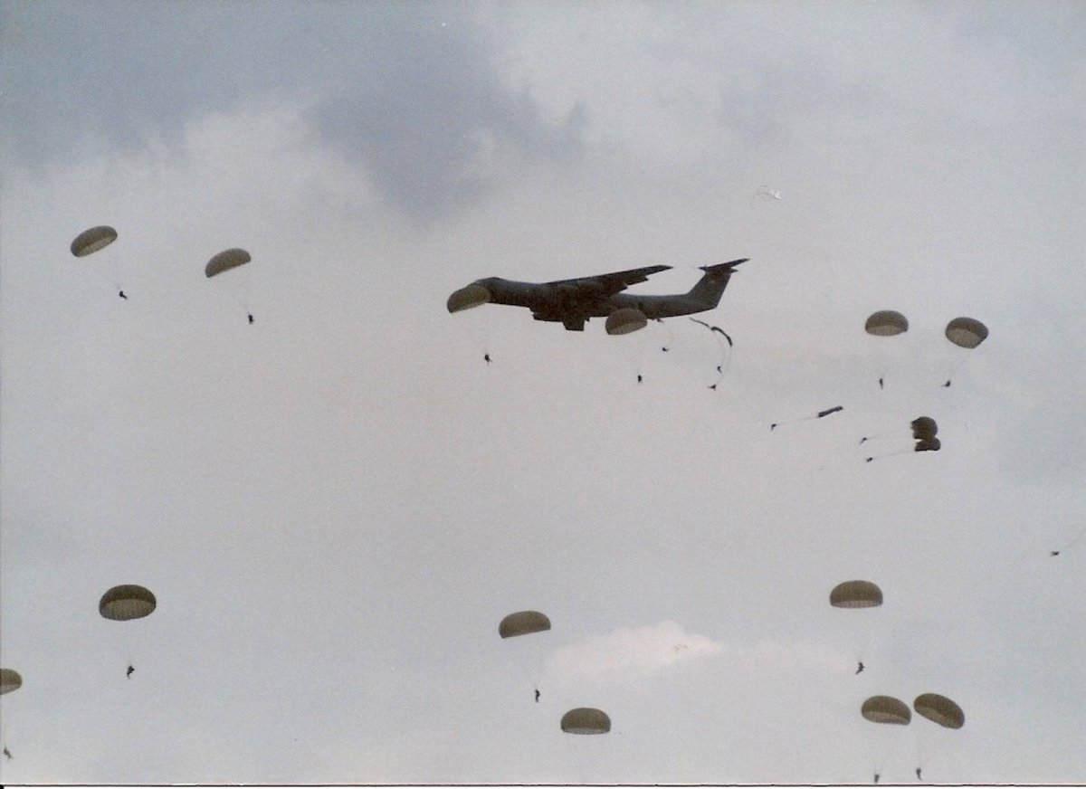 Paratroopers from the 82nd Airborne Division jump out of C-141s.