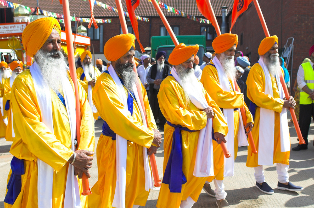The Panj Pyare - The five beloveds carrying the Sikh flags called Nishan Sahib.
