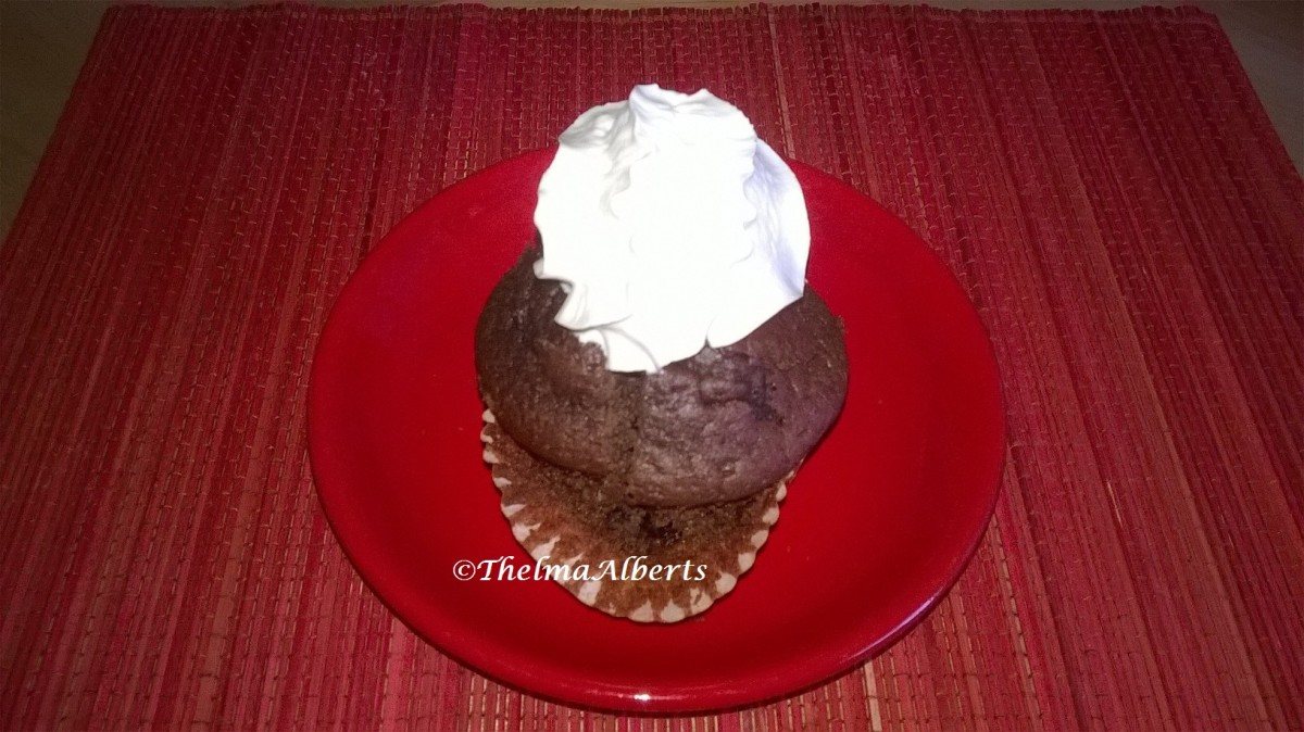 Chocolate Cranberry Muffin with whipped cream.