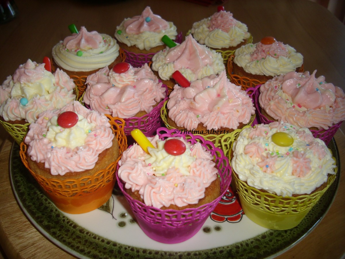 My self baked cupcakes with butter icing and candies.