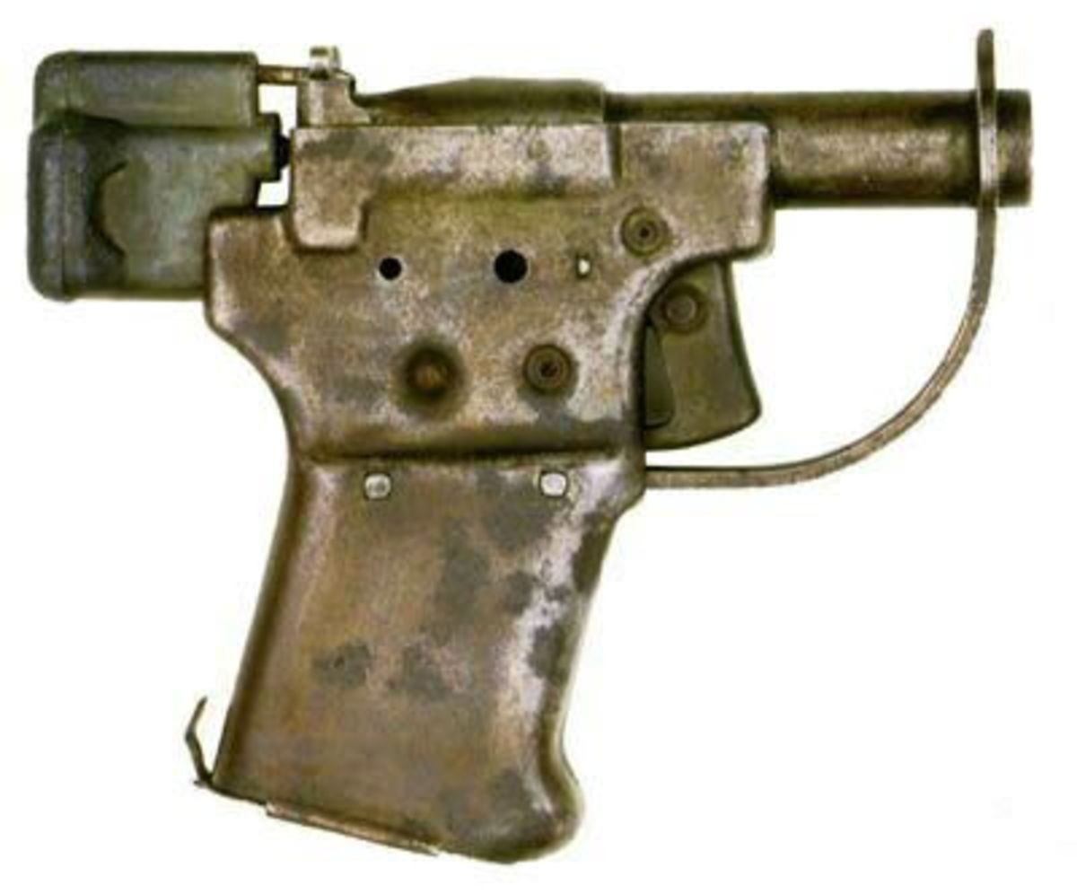 Single shot 0.45 ACP pressed steel pistol dropped to the resistance.