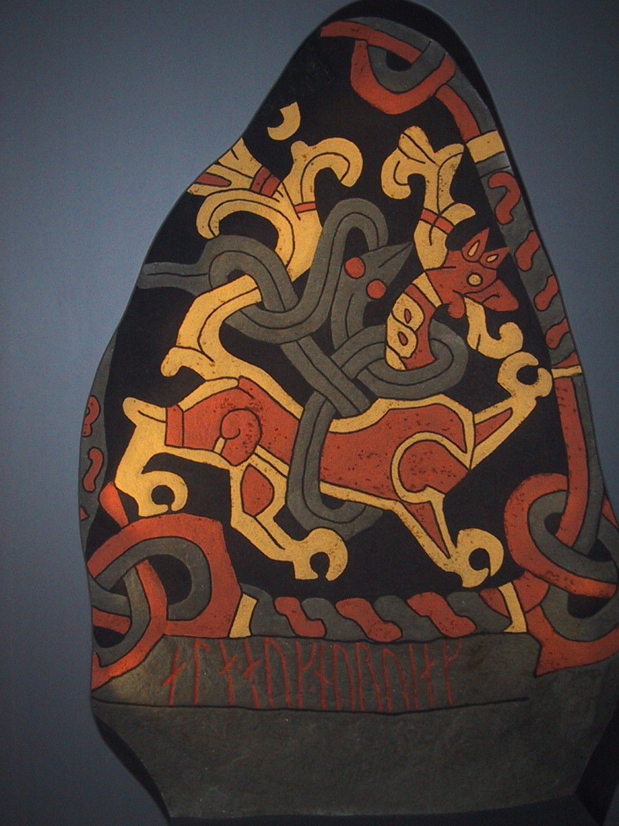 "This colourful ""lion and snake"" scene is from a reproduction of Gormsson's rune stone, painted in the bright colours that would have featured on the original."