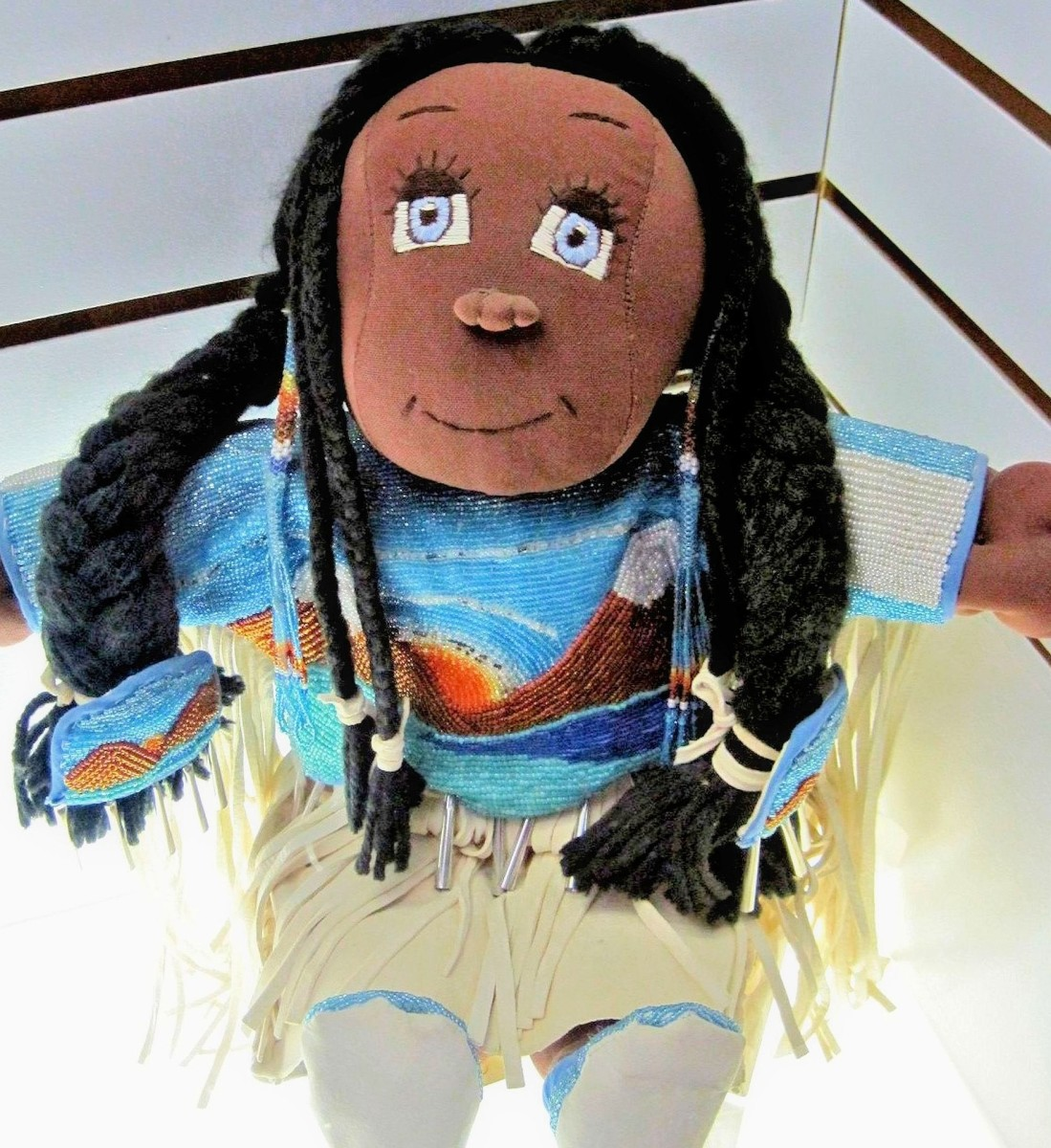 A stuffed American Indian doll.
