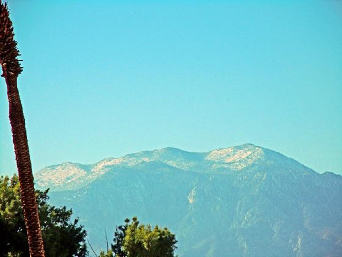 Winter camping in Palm Springs, California. Palm trees below and snow on the mountain tops.