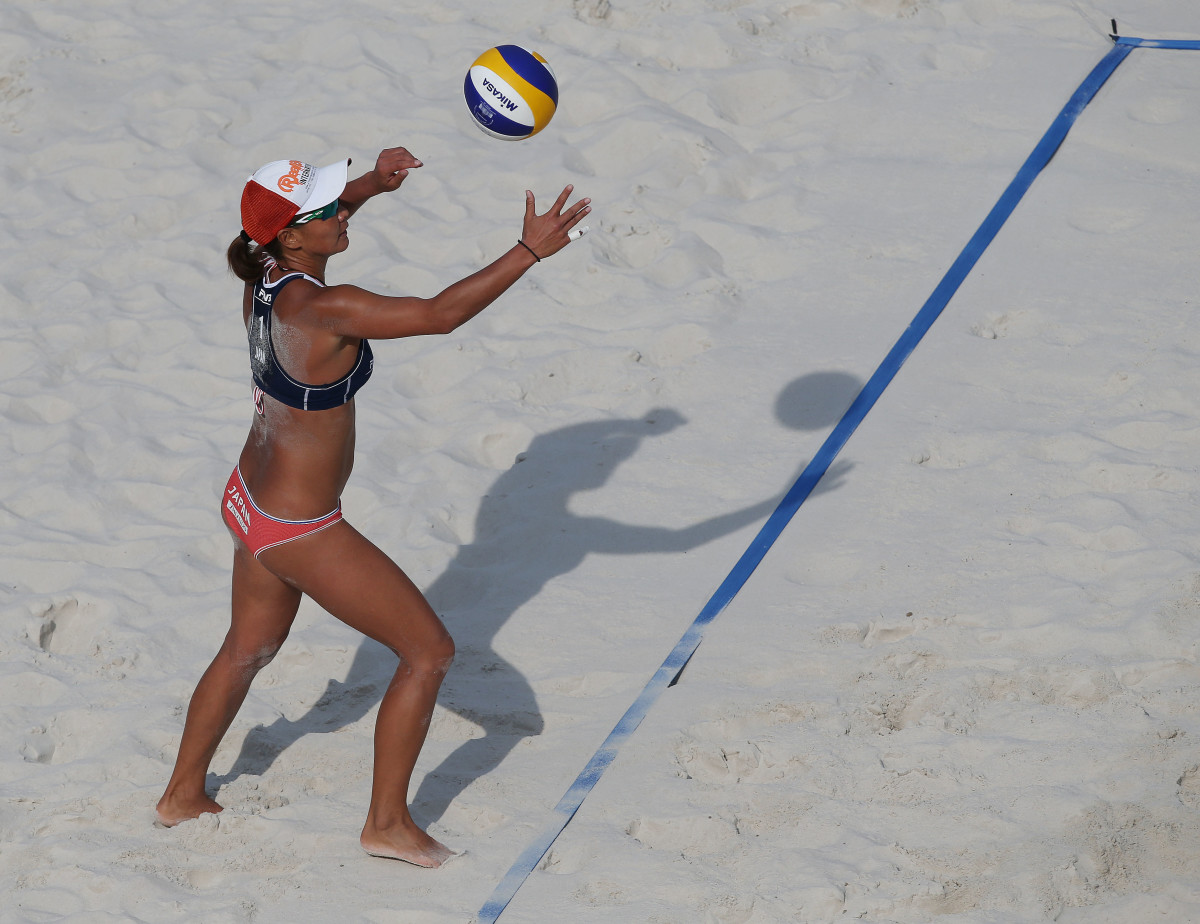 Japan's Shinako Tanaka in the middle of her serve during a match.
