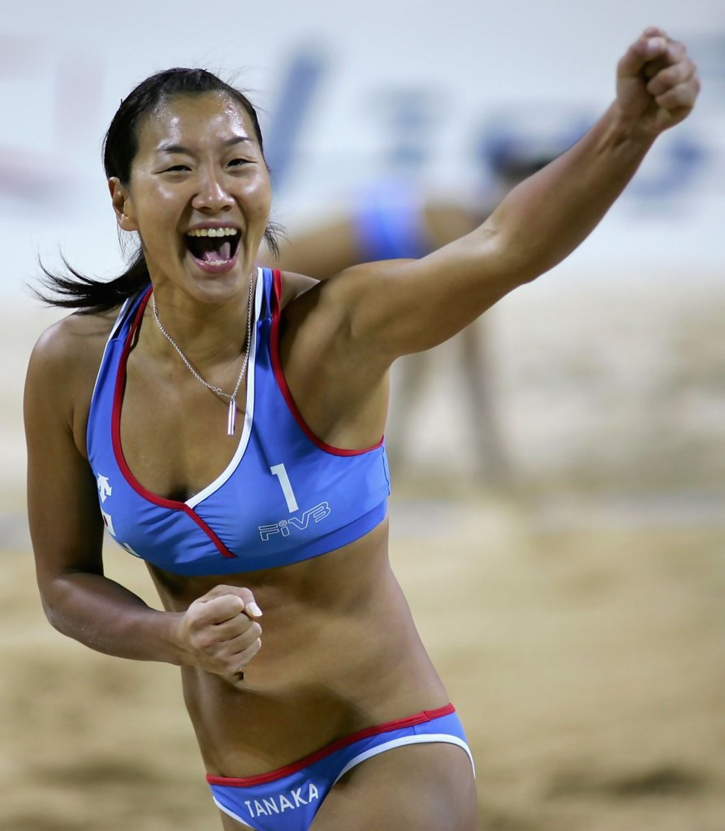 Shinako Tanaka of Japan celebrates winning a point against China in the final match.