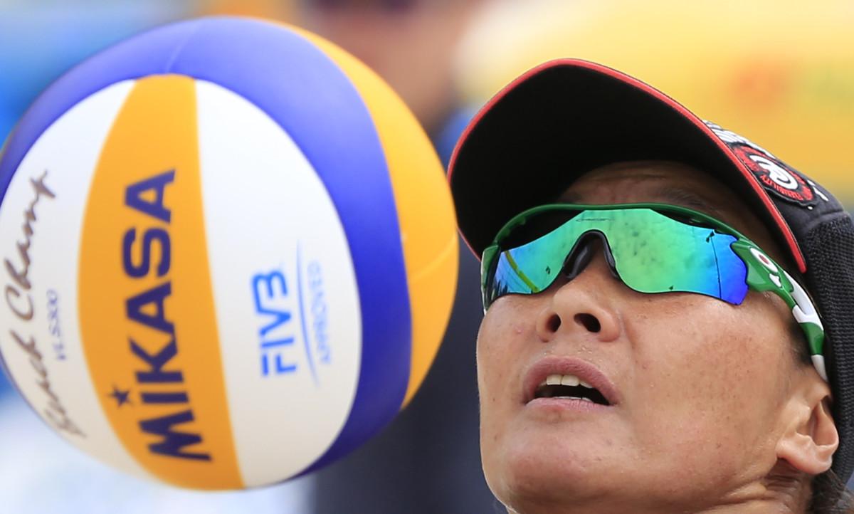 Shinako Tanaka about to serve the ball during a match in Prague, Czech Republic.