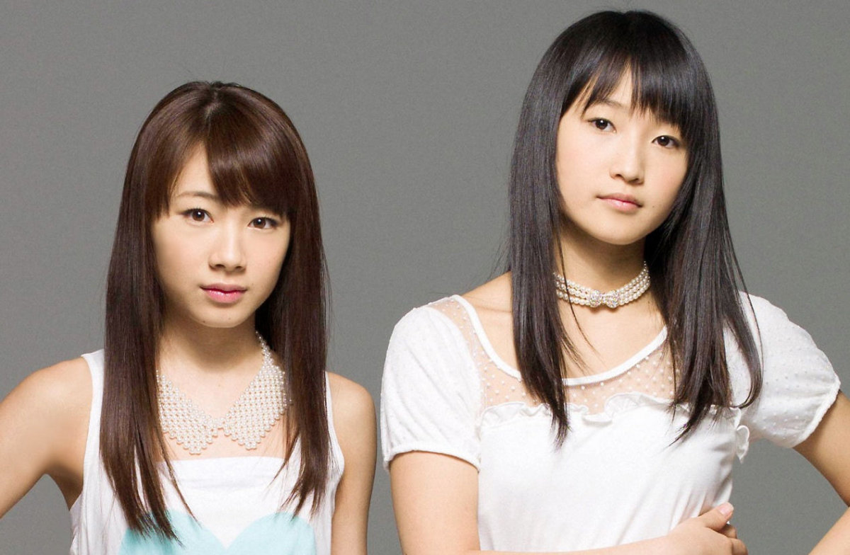 Ayumi Ishida (left) of Sendai, Japan is pictured here with Riho Sayashi during a photo session for Hello! Project.