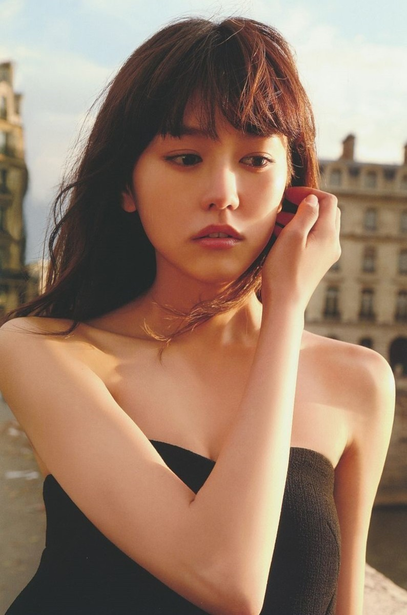 A photo of the beautiful Mirei Kiritani from her first photo book called Shitsuren Ryokou Paris as she poses for a photo in Paris, France.