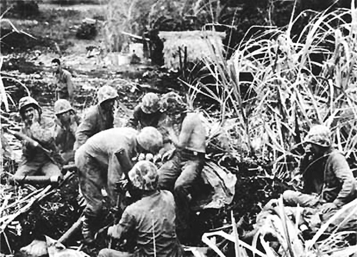 Marine mortar crew providing supporting fire in Saipan.