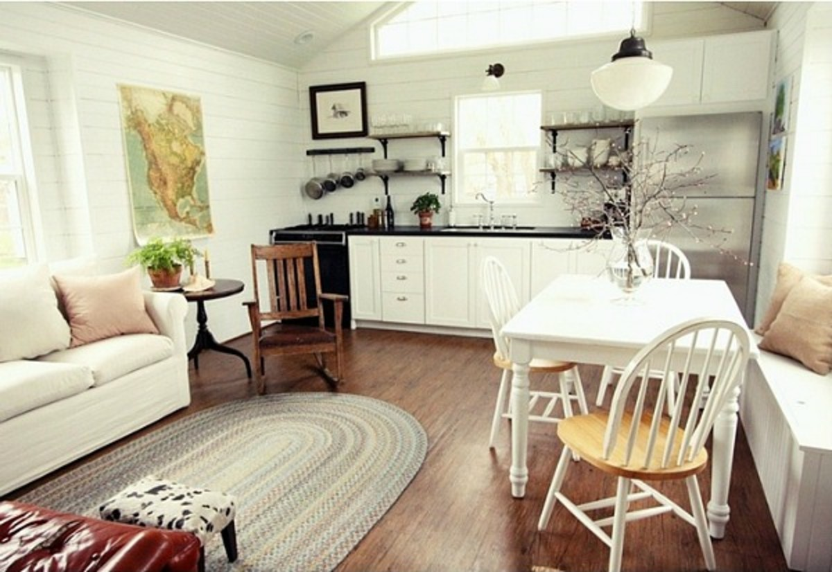 A family of five live happily in 665 square feet, which features one main floor bedroom, one bathroom and a loft for the children.