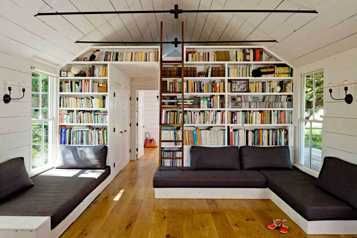 The ladder accesses a small loft with bed where the couple sleep.