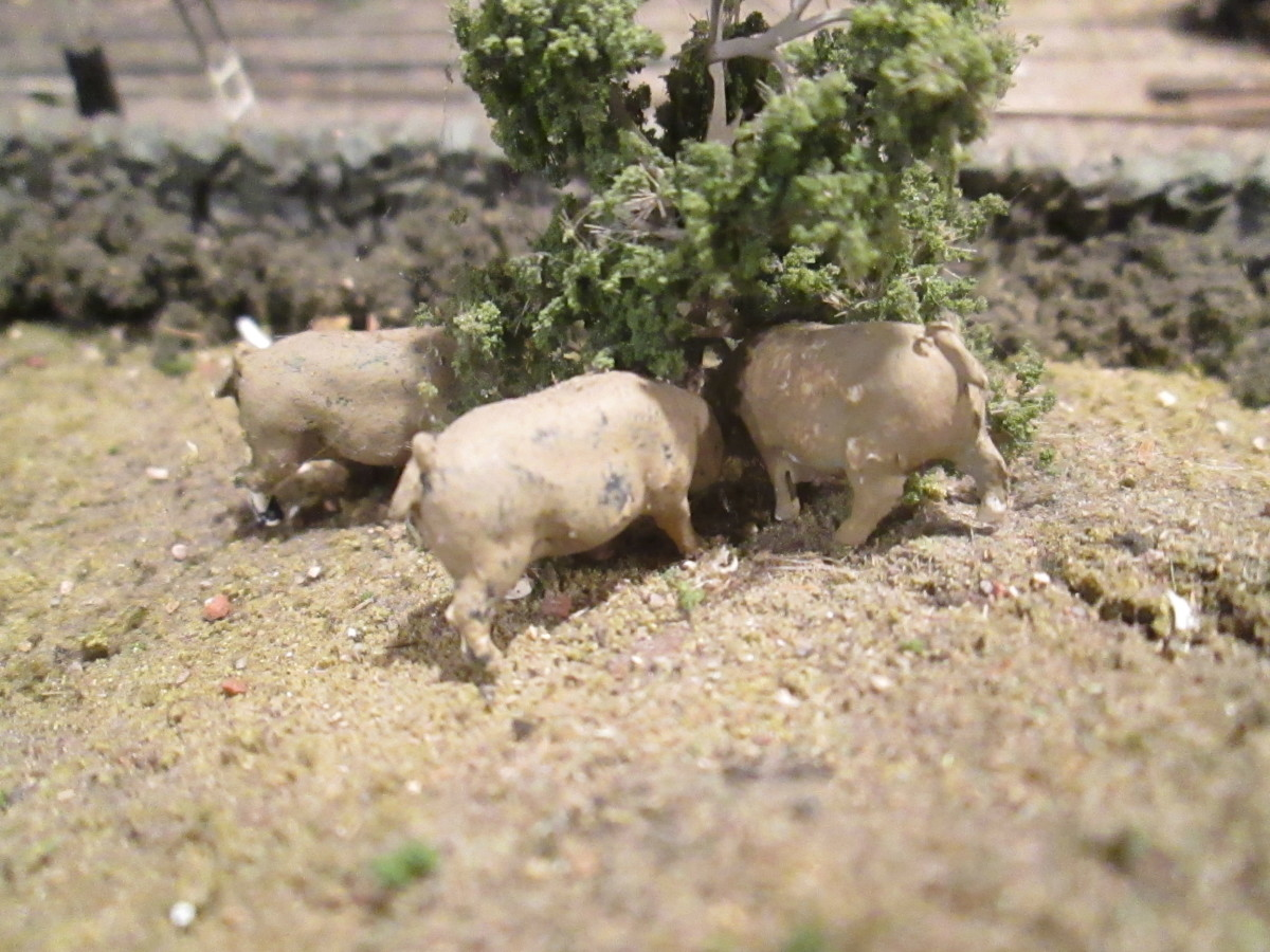 And don't forget livestock. Here are a few pigs rooting under a small tree... what for? Your fields and surrounding land give clues