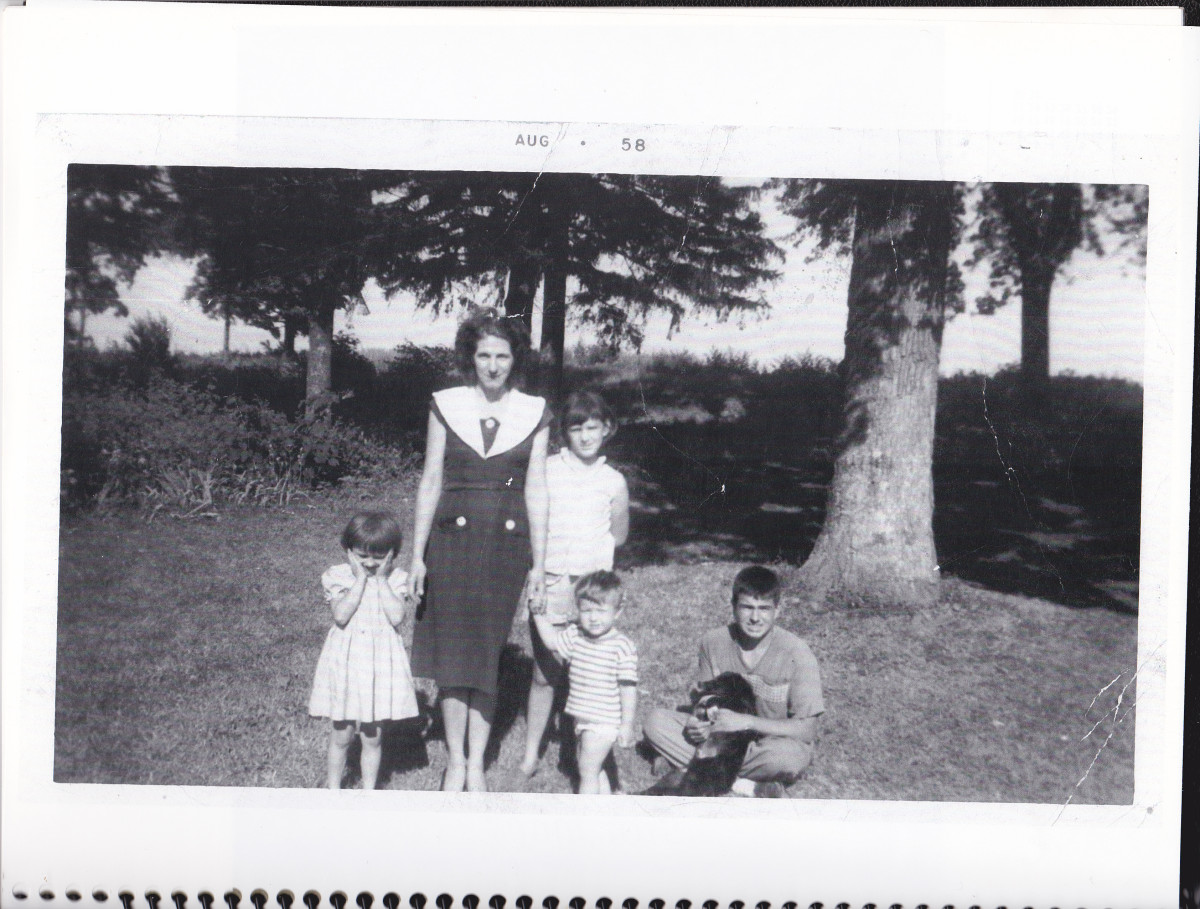 Picture taken in 1958 on the front lawn of our property.  Holding a dog, I am pictured with my mother, oldest sister, Beatrice, sister Pat, and toddler brother Philip.